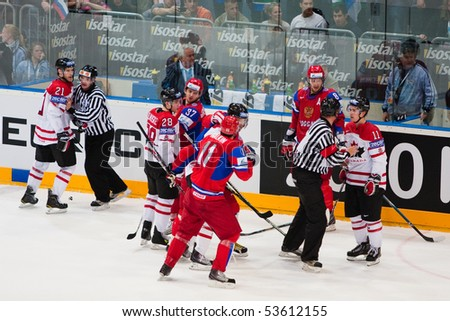 COLOGNE, GERMANY - MAY 20 : 2010 Ice Hockey World Championship. Fight during quarterfinal game between Russia and Canada. Russia win 5:2. April 20, 2010 in Cologne, Germany