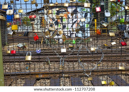 COLOGNE, GERMANY - MAY 11: lockers at the  Hohenzollern bridge symbolize love for ever on May 11,2011 in Cologne, Germany. 40000 lockers of loving couples are on that heavily used railway bridge.
