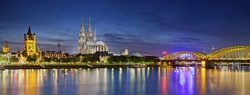 Cologne, Germany. Panoramic image of Cologne with Cologne Cathedral during twilight blue hour.