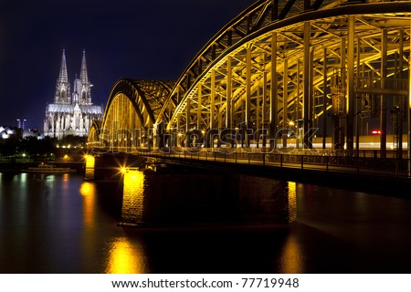 Cologne Gothic Cathedral and bridge at night