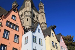 Cologne Old Town, Germany. Colorful architecture of Fish Market (Fischmarkt) and Great Saint Martin Church.