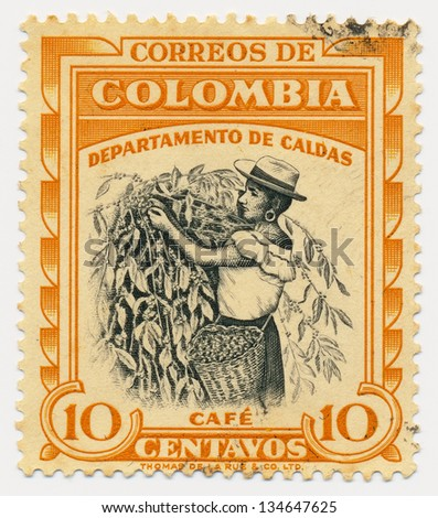 COLOMBIA - CIRCA 1956: A stamp printed in Colombia, shows Coffee picker, Caldas, circa 1956