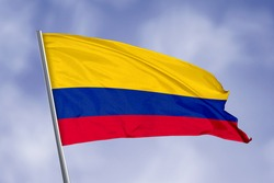 Colombia flag isolated on sky background. close up waving flag of Colombia. flag symbols of Colombia.