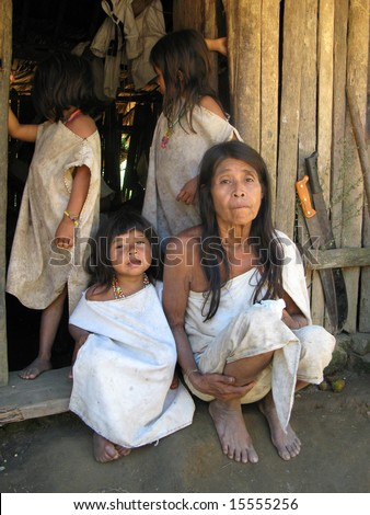 COLOMBIA - JANUARY 28: Indian little girls in front of a hut next to an old woman in traditional clothes. Great Trekking adventure January 28, 2008 in Colombia.