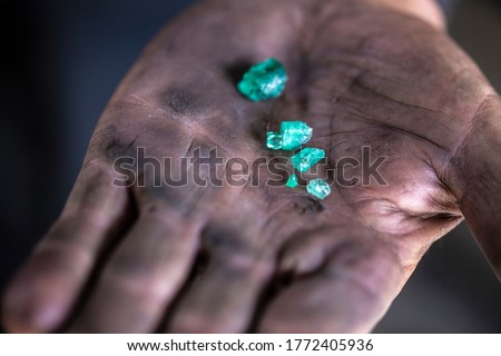 Colombian emerald miners in Muzo, Boyaca in the Santander department of Colombia. It is estimated that Colombia accounts for 70-90% of the world's emerald market.