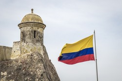 Colombian flag and tower of a fortress