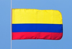 Colombian flag in the wind against the sky