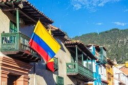 Colombian flag on a historic building in La Candelaria neighborhood in Bogota, Colombia