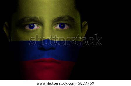 Colombian flag painted/projected onto a man's face. - stock photo