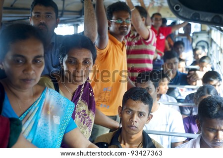 COLOMBO, SRI LANKA - FEB. 22: Sri Lankan people inside public bus on Feb 22, 2011 in Colombo. Colombo is the largest city and former capital of Sri Lanka with population about 1 million people.
