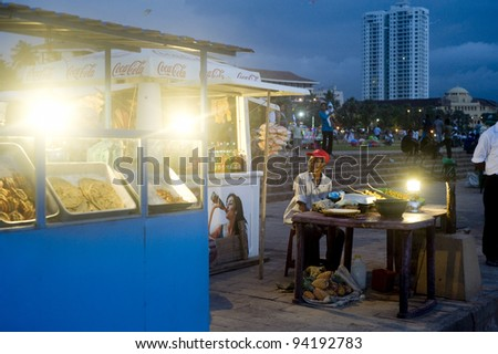 COLOMBO, SRI LANKA - FEBRUARY 22: Traditional fast food on the quay on  Feb 25, 2011 in Colombo, Sri Lanka. Colombo is the largest city and former capital of Sri Lanka with population about 1 million