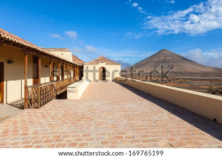 Colonial architecture and the volcano on the horizon
