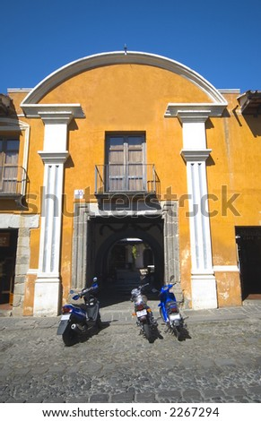 colonial building hotel with motorbikes antigua guatemala