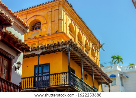 Colonial facades of balconies with vivid colors in the historical walled center, at the morning