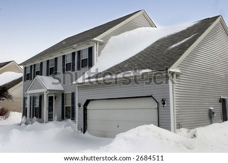Colonial Home Covered in Snow