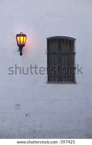 "Colonial house's wall lightened by beginning of the century ""farolito"""