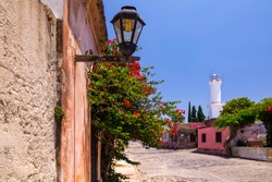 Colonial street and houses at summer day. Colonia. Uruguay.
