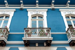 Colonial style architecture with blue and white facade and balcony, Quito, Ecuador.