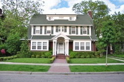 Colonial Style Home in Suburban Residential Neighborhood with Beautifully Landscaped front yard lawn