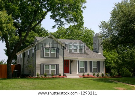 colonial style house with extremely red front door in suburban community