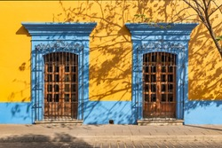 Colonial style Mexican wooden door Colorful lintel over Mexican house window door