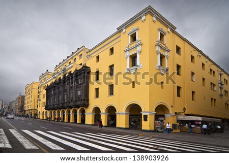 Colonial yellow building at main square called Plaza de Armas, Lima, Peru, on a cloudy day