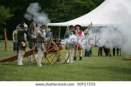 COLONIE - May 16: French and Indian War Reenactment members fire a cannon at the Schuyler Flats Cultural Park - May 16, 2009 in Colonie, NY
