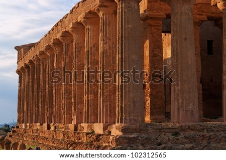 Colonnade of ancient Concordia temple in Agrigento, Sicily, Italy at sunset