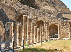 Colonnade of Quadriportico at Ruins of Pompeii. The city was an ancient Roman city destroyed by the volcano Vesuvius. Pompei, Campania, Italy.