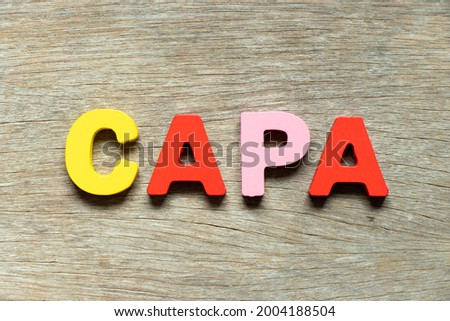 Color alphabet letter in word CAPA (abbreviation of corrective action and preventive action) on wood background Stock fotó ©