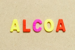 Color alphabet letter with word ALCOA (Abbreviation of Attributable, Legible, Contemporaneous, Original and Accurate) on wood background