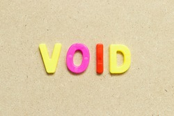 Color alphabet letter with word void on wood background