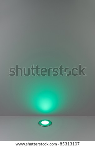 color background with green lighting bulb and blank space for text or object