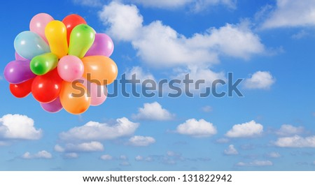 Color Balloons flying in the Blue sky