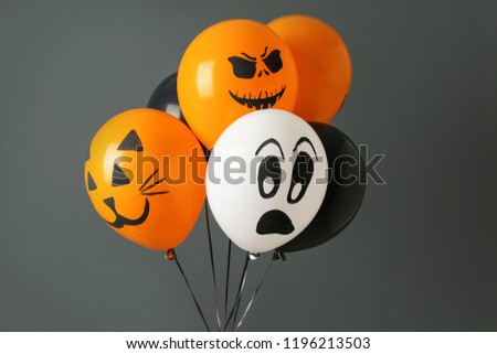 Color balloons for Halloween party on gray background #1196213503