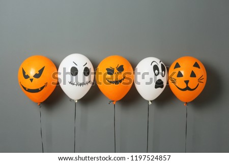Color balloons for Halloween party on gray background #1197524857