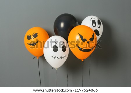 Color balloons for Halloween party on gray background #1197524866