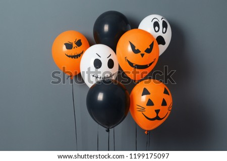 Color balloons for Halloween party on gray background #1199175097
