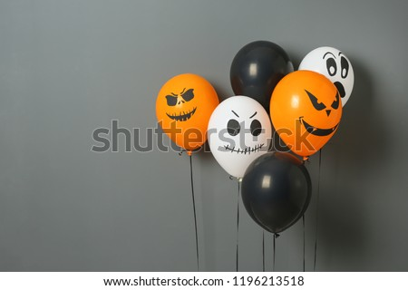 Color balloons for Halloween party on gray background. Space for text #1196213518