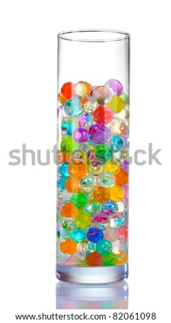 Color balls in glass vase isolated on white