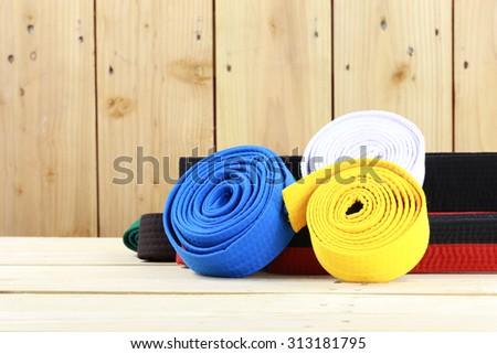 Color belt of martial art on wood floor