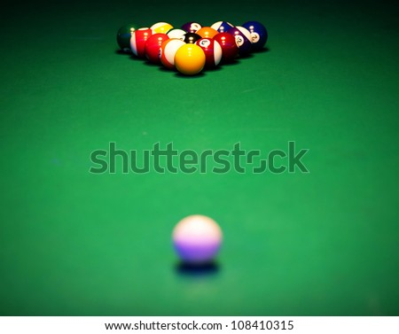 Color billiard balls on a green table