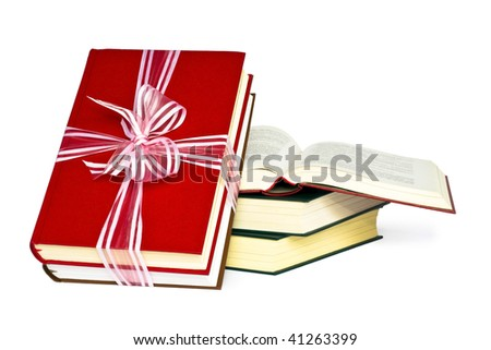 Color books, tied to a gift. - stock photo