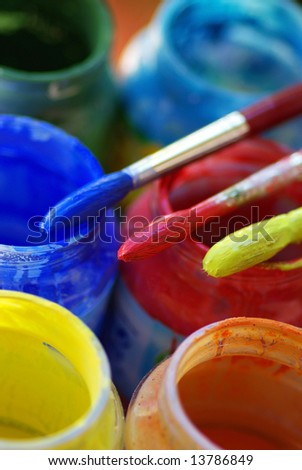 Color bottles and brushes for artistic paintings.