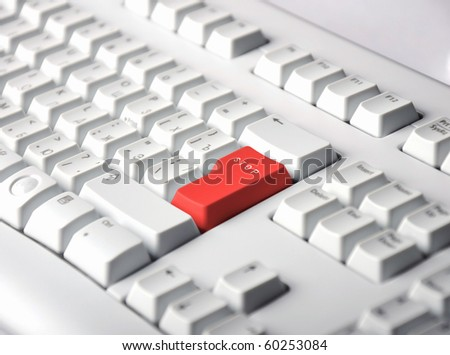 Color button on the background of a white keyboard