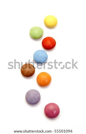 color candies in a row isolated on white