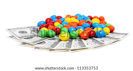 color candy with money isolated on white background