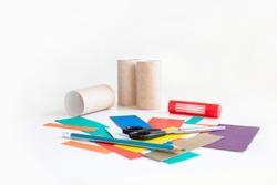 Color cardboard trim, pencil, scissors, glue and empty toilet rolls. Set for applique. Hobbies and leisure. Activities for children