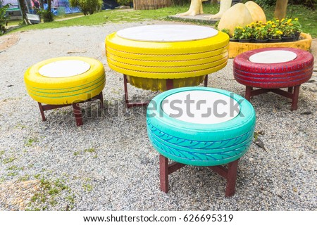 Color Chair Tire in Garden,Reuse Wheel Playground,Used Rubber Tire decoration in field,Colorful Recycle Toy,Be save Environment Idea,Add value change Reuse Concept.