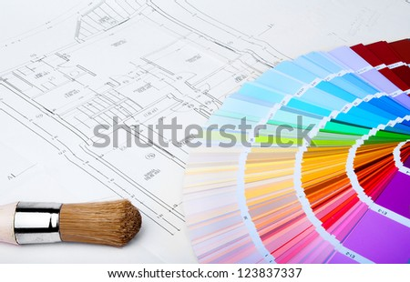 color chart and brush on the blue prints home Plans - stock photo